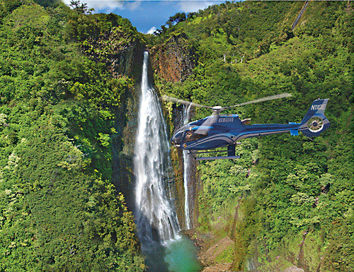 A Blue Hawaiian Eco-Star offers a stunning view of Kauai's spectacular Manawaiopuna Falls.