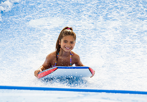 Get a taste of the surfing lifestyle on the Tsunami FlowRider®, the park's  second new addition!