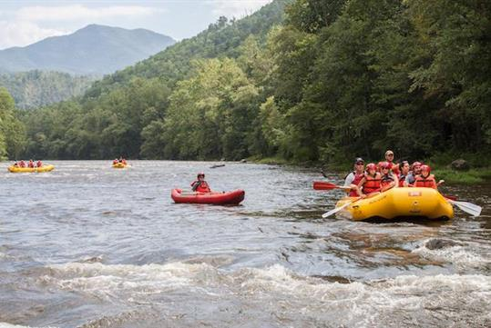 A scenic Class I-II float trip bordering the Great Smoky Mountains National Park, the Lower Pigeon River is perfect for families with young kids. - Pigeon River Rafting with NOC in Hartford, Tennessee