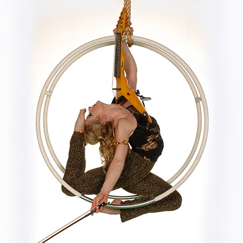 Janice Martin, the world's only acrobatic aerial violinist.