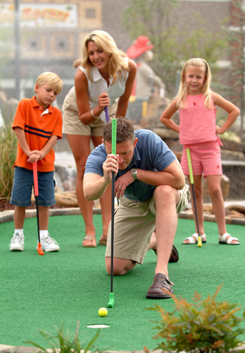 Dad Lining Up the Shot - Firehouse Golf in Pigeon Forge, Tennessee
