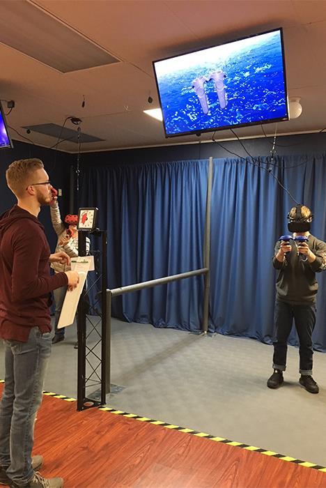 Staff Tech Helping Customers Play The Games Successfully In Virtual Reality Room